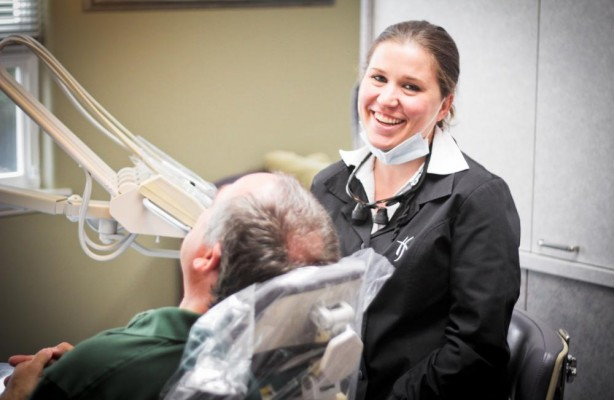 Our staff working with an actual patient of Dr. Nichole Martin, our dentist in Lynnwood, WA.